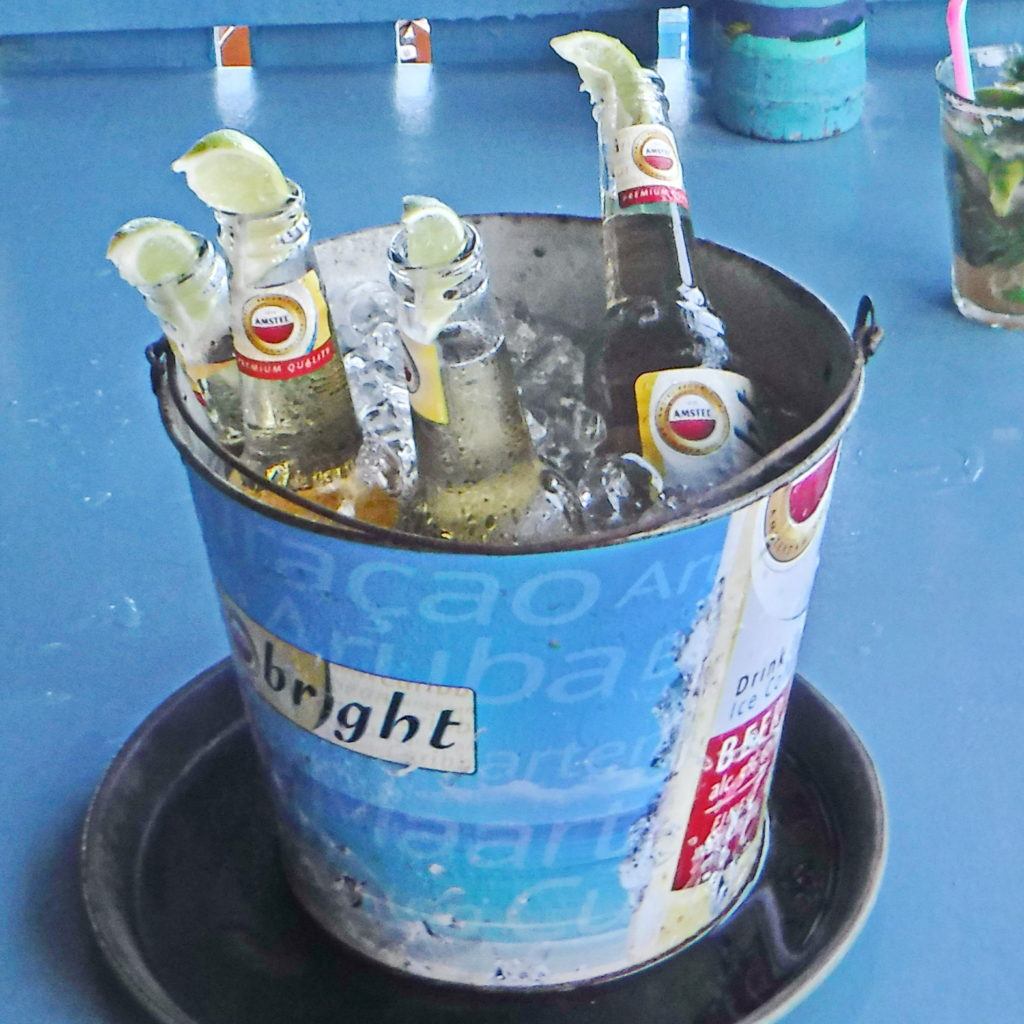 Nothing says Caribbean vacation better than an ice-cold bucket of beer at a beach bar.
