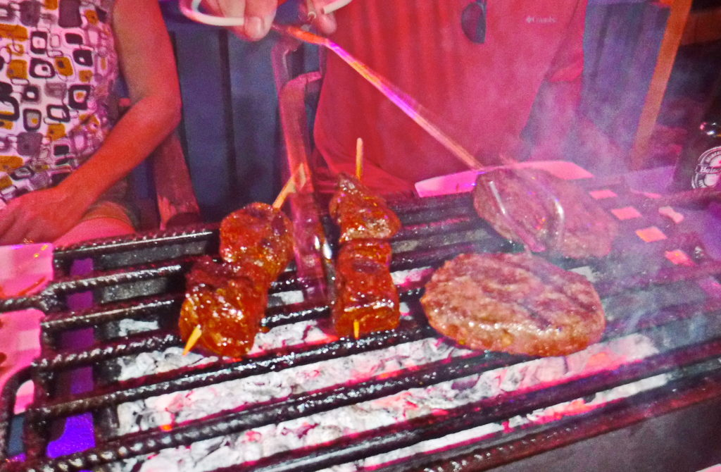 Grill your own dinner at Hang Out Beach Bar Table BBQ