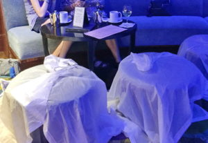 A glass of wine, a cup of tea, and space to dry off our ponchos too - this is the cozy blue glow of the Wave Lounge at Disney's Contemporary Resort.
