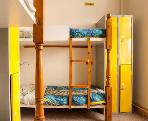 A sleeping room at Castle Rock hostel. Lockers next to the bunks.